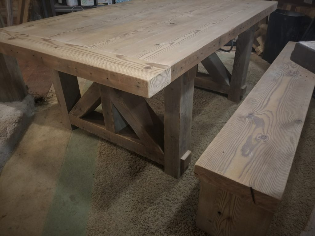 "Not yet stained farmhouse table made from 1942 3"" thick Iowa barn beams"