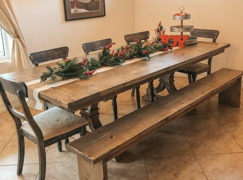Trestle farm table with curved pedestals and matching bench