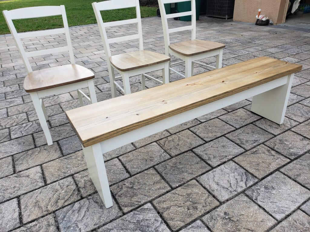 weathered oak bench and ladderback chairs with white frames